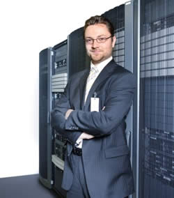 IT Engineer Posed by Server Bank Photo