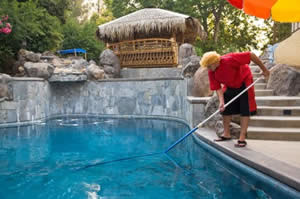 Resort Employee Cleaning Swimming Pool Photo
