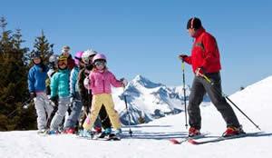 Ski Instructor Teaching Kids to Ski Photo